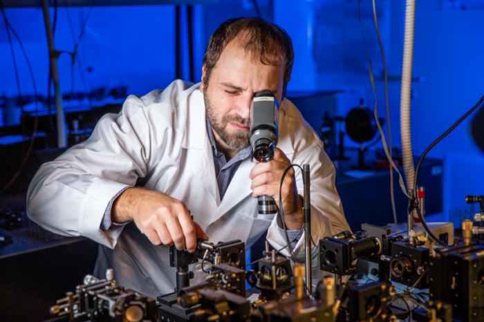 Dr. A. Černoch in the laboratory of quantum information processing